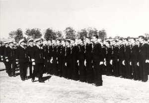 HMAS Nirimba's commissioning company being inspected by Rear Admiral Henry Showers, 1 April 1953.