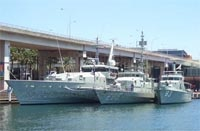 Figure 1: HMAS Armidale, HMAS Townsville and the former Attack class patrol boat Advance (Mr Andrew Mackinnon)
