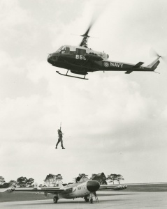 An RAN Iroquois conducts rescue training at NAS Nowra, flying over a Sea Venom.