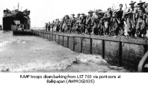 RAAF troops disembarking from LST703 via pontoons at Balikpapan (AWM OG3035)
