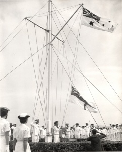The RAN White Ensign is raised for the first time at HMAS Watson on 1 March 1967.