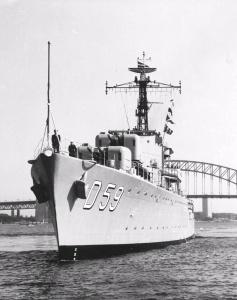 HMAS Anzac departing Sydney Harbour to begin her second tour in Korea, September 1952