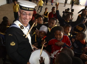 Able Seaman Damian Dowd with Students from Ukhanyo School in Masephumelele in South Africa.