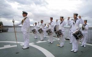 The Royal Australian Navy Reserve Band Hobart march onto the flight deck of HMAS Parramatta for a Ceremonial Sunset.
