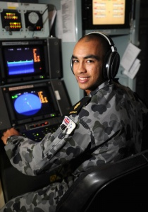 Able Seaman Combat Systems Operator Brendan Read in the operations room on HMAS Parramatta.