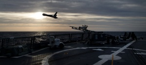 ScanEagle, an unmanned aerial vehicle launches from the flight deck of HMAS Newcastle during operational evaluation trials. Photographer: ABIS Nicolas Gonzalez.