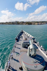 HMAS Newcastle prepares to berth alongside in Diego Suarez in Madagascar.
