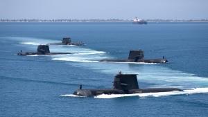 Collins Class submarines HMAS Collins, HMAS Farncomb, HMAS Dechaineux and HMAS Sheean in formation while transiting through Cockburn Sound, Western Australia, February 2019.