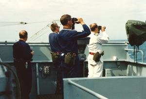 Captain Moore (white overalls) with members of his bridge team closed up during operations in the Persian Gulf.