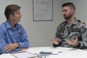 Commander Andrew Mierisch (left) speaks with Lieutenant Connor Mooney-Collett (right) during a Leadership Coaching Program held at Defence Plaza in Sydney. Photographer: ABIS Leon Dafonte Fernandez.