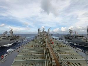 HMA Ships Ballarat and Parramatta conduct a replenishment-at-sea with HMAS Sirius as they sail through South China Sea. Photographer: LEUT Sarah Lucinsky.