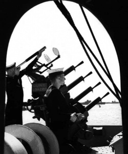 Signalmen 'Slim' Roper and Joe Harris keeping a visual lookout in Alexandria Harbour, Egypt, 1941.
