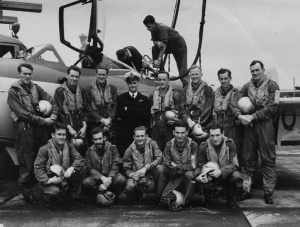 808 Squadron in 1955 posing before a Sea Venom onboard Melbourne. Back row, left to right; LEUTs Peter Wyatt and David Hilliard, LCDRs Peter Seed and George Jude, LEUTs Barry Thompson, Alan Cordell, Edward Wilson and Geoffrey Gratwick. Front row, left to right; LEUTs Ronald McIver, Stanley Carmichael, Keith Potts, Neil Ralph and Bernard Brennan. Thompson and Potts were both killed when their Sea Venom crashed into the sea in 1956. Stanley Carmichael also lost his life in similar circumstances in 1959.