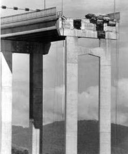 Two cars teeter on the edge following the Tasman Bridge Disaster.