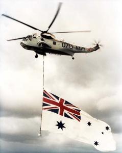 A Sea King flies the White Ensign.