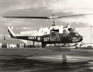 An Iroquois takes off from HMAS Albatross for the last time on 31 May 1989, piloted by LEUT Keith Champion and Albatross Commanding Officer, CDRE Matt Taylor, sitting right seat.