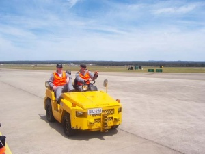 Ground crew on the tarmac at HMAS Albatross.