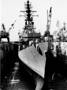 HMAS Brisbane (II) in dry dock in the Boston Naval Shipyard. Her commissioning day was declared 'Brisbane Day' throughout the 'Commonwealth' of Massachusetts.