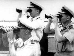 Commodore Collins, Captain Dechaineux and Commander Gatacre on the compass platform of HMAS Australia. Dechaineux was killed and Collins badly injured when a Japanese suicide aircraft struck the bridge on 21 October 1944.