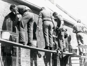 A working party helps to construct the Chapel of St George the Martyr.