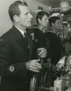 Warrant Officer Tim Collins, OAM, a well known RAN personality at the helm of Stalwart in 1983. With him are Leading Coxswain L Westbrook and Able Seaman Quarter Master Gunner P Gearing.