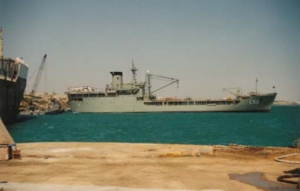 HMAS Tobruk moored at the RO/RO facility Mogadishu with her Sea King ranged on deck, January 1993.