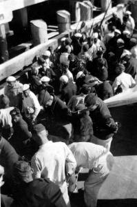 Kormoran survivors being landed in Carnarvon from HMAS Yandra.
