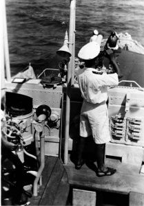 HMAS Yarra's commanding officer LCDR WH Harrington closed up on the bridge.