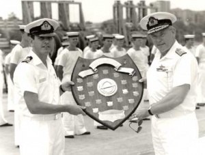 Rear Admiral R Walls, AO, RAN presenting Lieutenant Commander M Sander, RAN, Commanding Officer of Ovens, with the Submarine Fighting Efficiency Shield.
