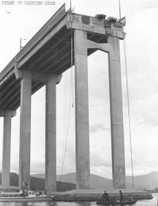 Two cars teeter on the edge following the Tasman Bridge Disaster.