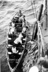 Quiberon's seaboat crew recovering a practice torpedo, circa 1943.