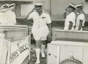 Rear Admiral Morrison crosses over from HMAS Hawk to HMAS Gull while visiting the ships in Hong Kong, 1965.