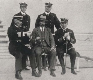 Australia's First Naval Board. Back row: Staff Paymaster Eldon Manisty, RN, Engineer Commander W Clarkson, RAN. Front row: Rear Admiral WR Creswell, RAN, Defence Minister Senator George F Pearce, Captain Constantine Hughes-Onslow, RN.