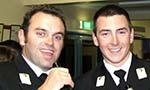 Two Midshipman relaxing at a social function.