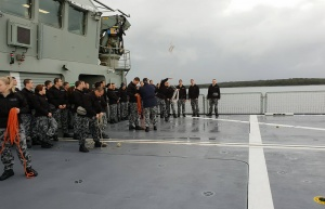 Recruits pictured practicing throwing heaving lines onboard MV Sycamore.