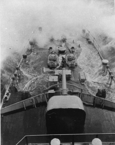 HMAS Adelaide takes water over the bow in 1939.