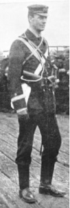 Paymaster Alfred Martin Treacy in marching kit as a member of the  Victorian Naval Brigade deployed to China in 1900 – 1901 Note the two gold stripes of the Paymaster rank (Equivalent to a Lieutenant) with the white cloth of the Accountant Branch in between