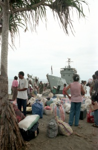 Internally Displaced People returning to Anzac Bay, Suai on HMAS Balikpapan, November 1999.