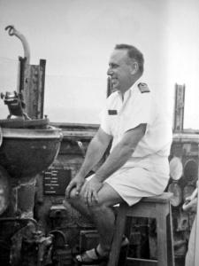Captain Waller on the open bridge of the light cruiser HMAS Perth (I).