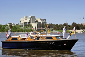 Her Majesty The Queen and The Duke of Edinburgh aboard the Admiral's Barge as it comes in to dock at Regatta Point near the Floriade site in Canberra.