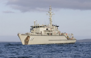 HMAS Yarra sits off the coast of Cremorne, Tasmania, during Exercise DUGONG 2015.