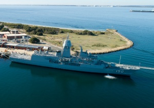 An aerial photograph of HMAS Anzac berthed at Fleet Base West in Western Australia.