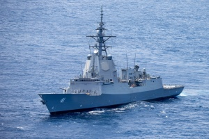 HMAS Brisbane sails in waters off the coast of NSW following an SM-2 standard missile-firing serial.