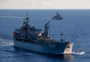 HMAS Sirius (left) and HMAS Anzac conduct a routine passage exercise in the South China Sea as part of their deployment throughout the Northern Indian Ocean and Southeast Asia.